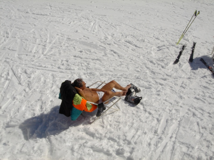 skiing and sunbathing